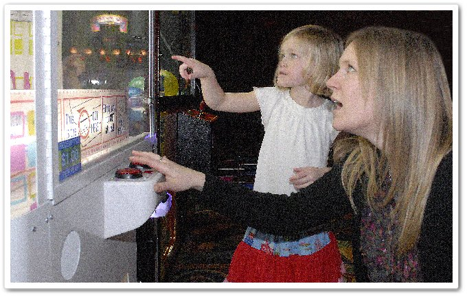 Mom and Daughter in Arcade
